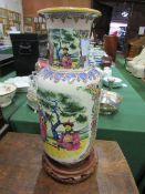 Tall rounded Chinese famille figural vase on stand.