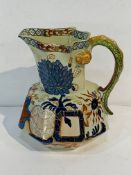 "Colourful Davenport Stone China jug with serpent handle, together with a blue and white ""mask"" jug."