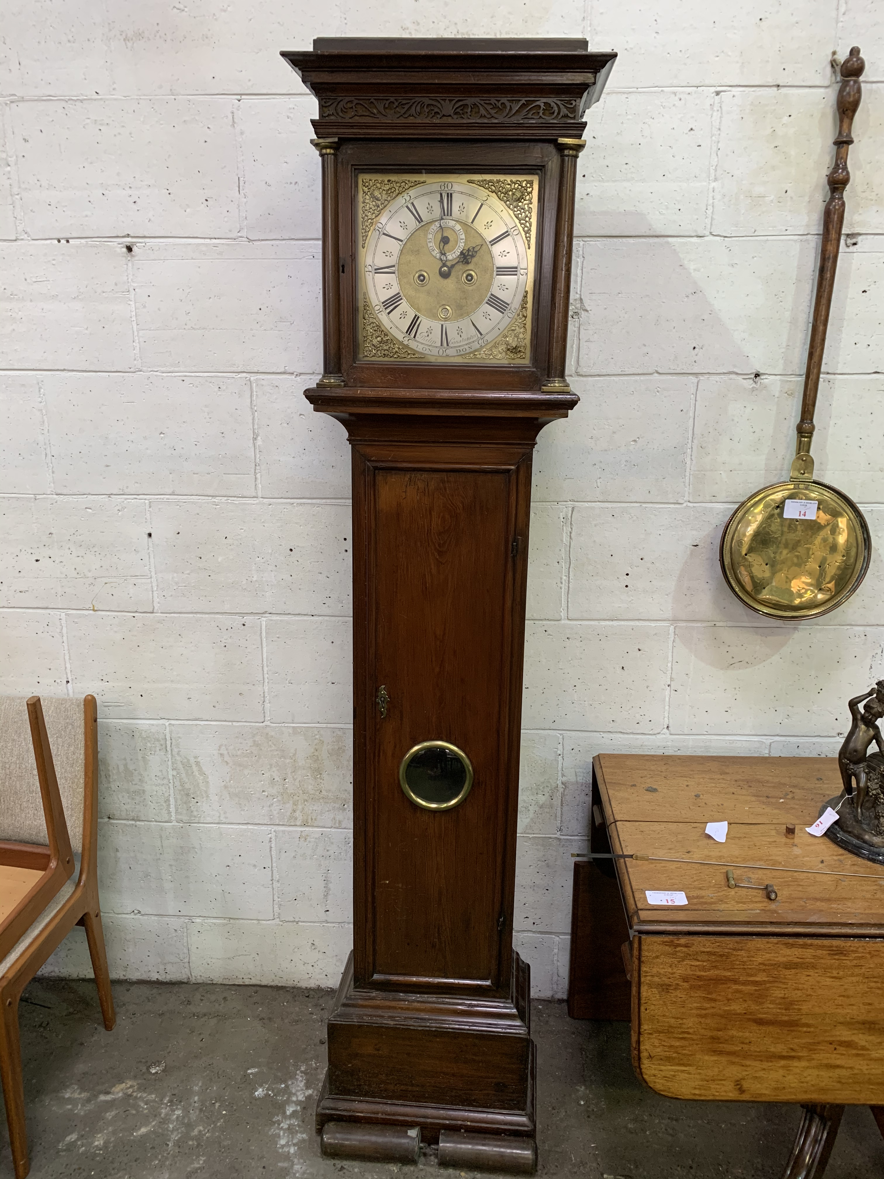 Lot 47 - 18th century mahogany and stained pine long case clock by Philip Constantin of London.