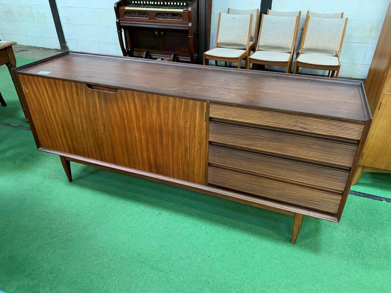 Lot 44 - 1950s teak sideboard with 2 cupboards and 4 graduated drawers.