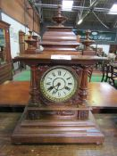 Oak case mantel clock with finial decoration.