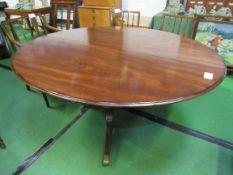 Mahogany oval tilt-top table on heavy pedestal.