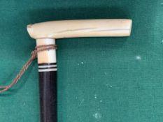 Fine ebony Dandy Stick with ivory handle and ball pomander.