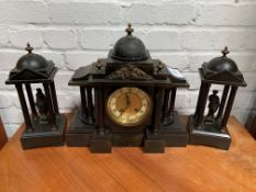 Slate clock set with two figurines garnitures.