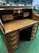 Late 19th Century/early 20th Century oak roll-top top pedestal desk.