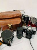 A Minolta SRT202 and two lenses