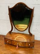 Mahogany shield shaped toilet mirror with 3 drawers to base.