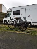 SPIDER PHAETON to suit 12 to 13hh pony. Painted black, on 12-spoke wheels with brass hub caps and e
