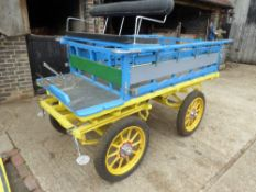 LONDON FRUIT VAN to suit 14 to 16hh cob. The open slatted body has a drop tailboard and is painted