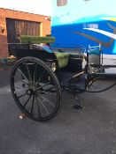 CAB FRONTED GIG to suit 13 to 14hh. Painted black with 46ins/ 14- spoke wheels with brass hub caps,