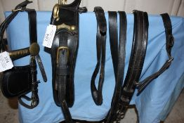 Set of black leather pony harness with brass fittings; no noseband or traces