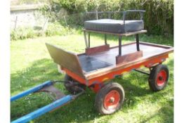 TROLLEY to suit a Shetland pony single or pair. In natural varnished wood with black
