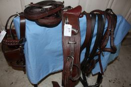 Part set of brown leather harness with traces; no breastplate or collar