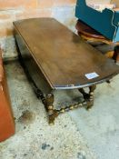 Ercol style low drop side gate legged table.