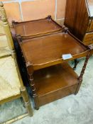 Pair of mahogany occasional tables with display shelf and two drawers below.