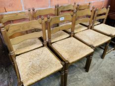 Set of six string seat dining chairs together with two similar.