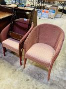 Pair of Lloyd Loom chairs with upholstered seats.