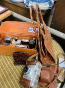 1950's handbag, crocodile skin wallet with silver trim, travelling toilet case and a Franka camera.