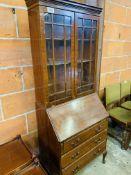 Mahogany glazed bookcase on bureau base size 75x46x192cms