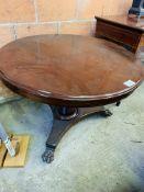 Mahogany circular tilt top dining table.