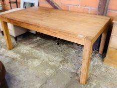 Oak laminate table on block supports.