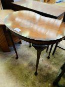 Mahogany kidney shaped occasional table.