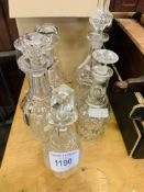 Box of crystal decanters with stoppers.