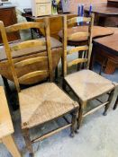 Pair of string seat ladder back chairs.