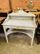 Painted washstand with top shelf, frieze drawer and shelf below.