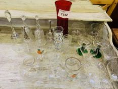 Quantity of drinking glasses and glass bells.