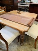 Mahogany wind-out table.