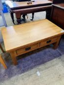 Oak low table with two double-sided frieze drawers, with slatted sides.