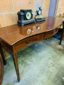 Mahogany serpentine fronted string inlaid sideboard.
