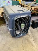 Large pet transport cage.