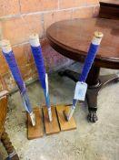 3 Hockey sticks mounted on wooden bases.