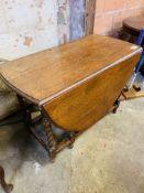 Oak dropside gate leg table with barley twist legs.