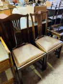 Two mid 19th century drop-in seat mahogany dining chairs with rail splat.