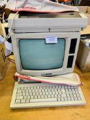 Amstrad PCW8512 Computer, printer, and keyboard.