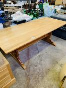 Pine table on end supports with centre stretcher, plus 4 matching chairs.