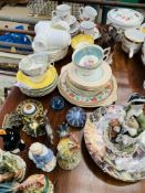 Assorted chinaware and figurines.
