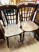 Two elm seat comb back kitchen chairs.