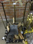 Two fire baskets, brass companion set, and brass frame spark guard. This item carries VAT.