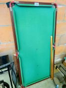 Snooker table with cues and a set of balls