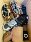 Two pairs of binoculars in leather cases.