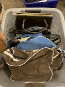Two boxes containg a large quantity of handbags.