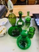 Quantity decorative green glass ware including two decanters.