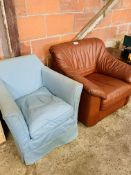 Small armchair upholstered in blue loose cover, and a brown leather armchair.