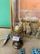 Brass oil lamp, pair of brass firedogs and a brass propeller.