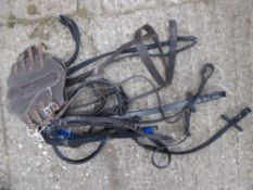 Qty of leather/webbing straps and a pair of leather brushing boots