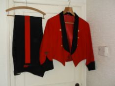 Red and black Royal Signals livery jacket with brass buttons and crest on the sleeves, and matching